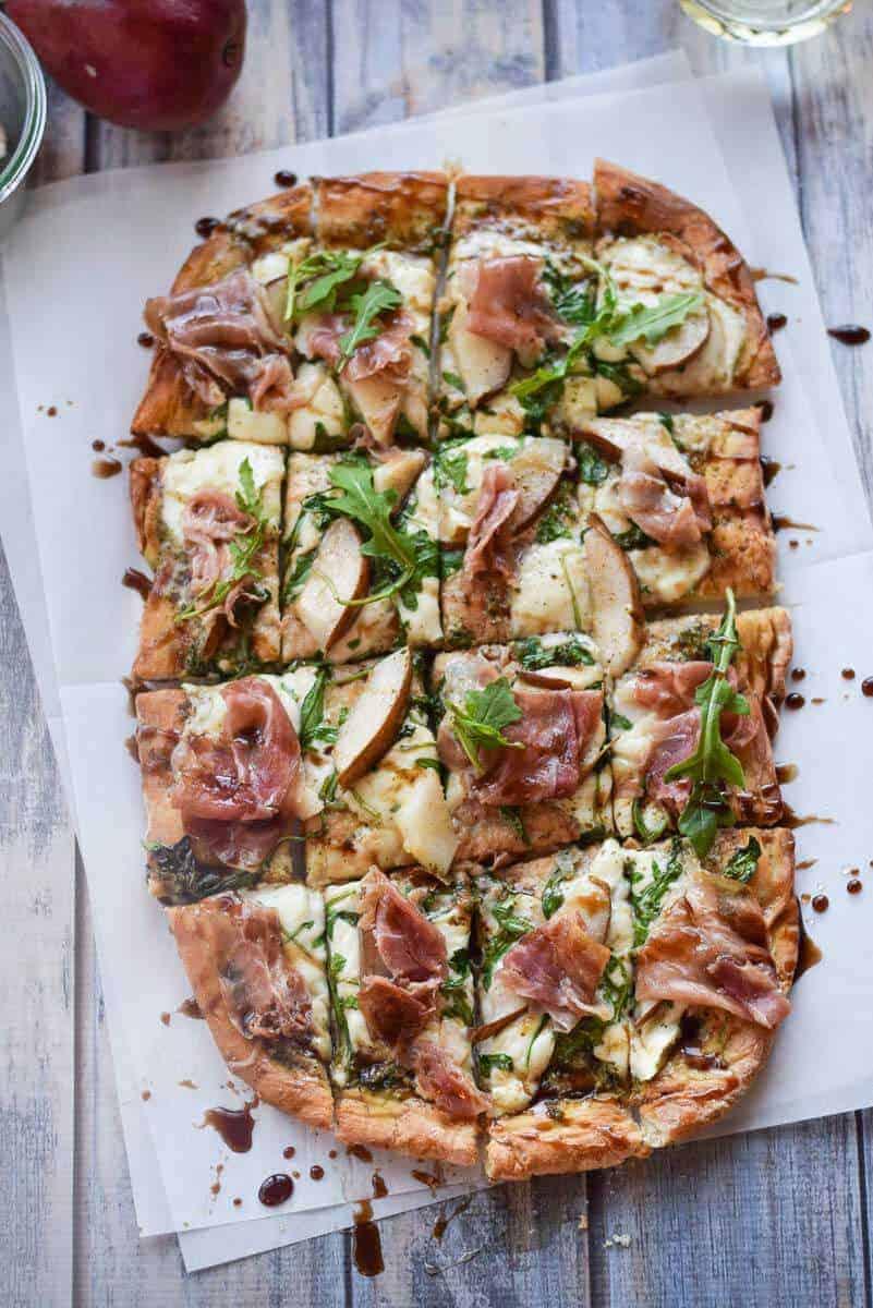 Arugula and Prosciutto Pizza - gluten free pizza topped with prosciutto, arugula and fresh mozzarella.