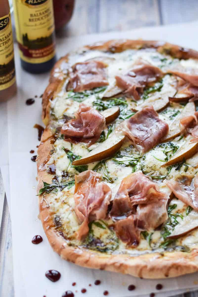 Arugula and Prosciutto Pizza - gluten free pizza topped with prosciutto, arugula and fresh mozzarella.