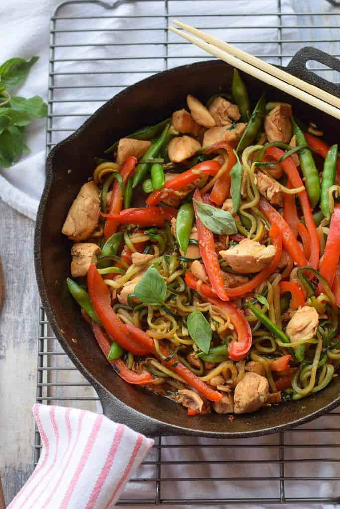 Chicken Thai Basil with Zucchini Noodles - Full of red peppers, sugar snap peas, stir fried chicken and a savory sauce over zucchini noodles.{gluten free, paleo, whole30}