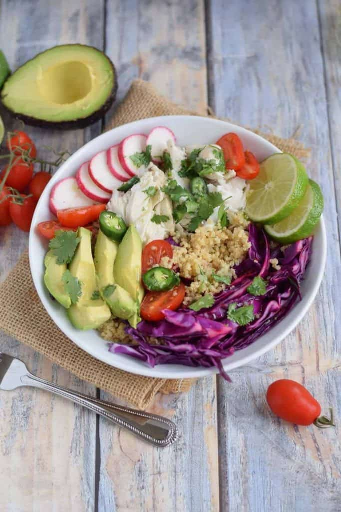 Fish Taco Grain Bowl in white bowl with avocado