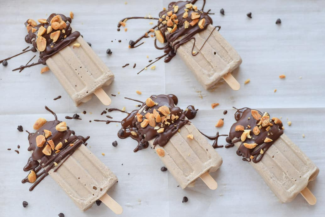Chocolate Peanut Butter Banana Popsicles with chopped peanuts