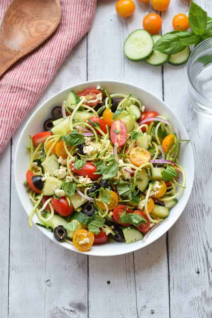 Greek Zucchini Noodle Salad in a white bowl