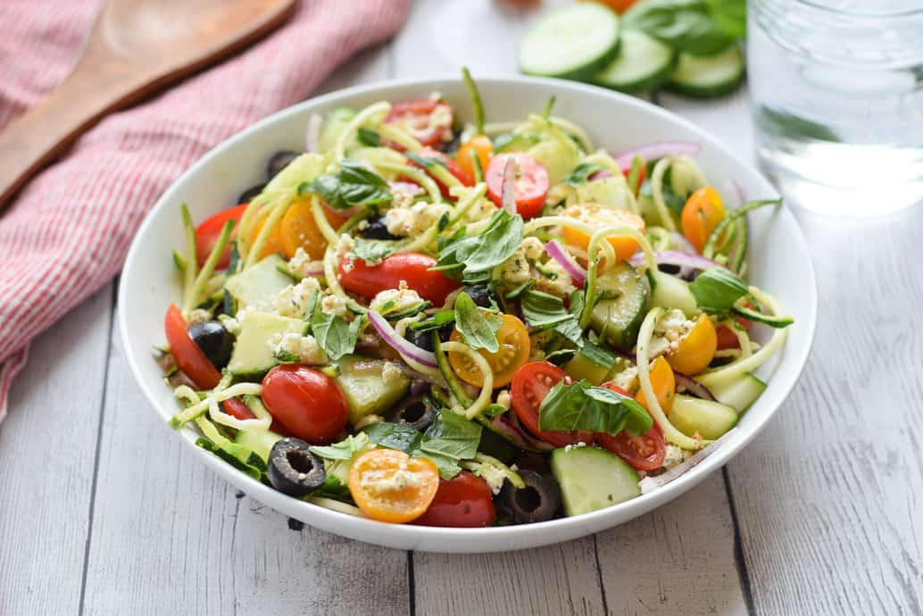 Greek Zucchini Noodle Salad in white bowl