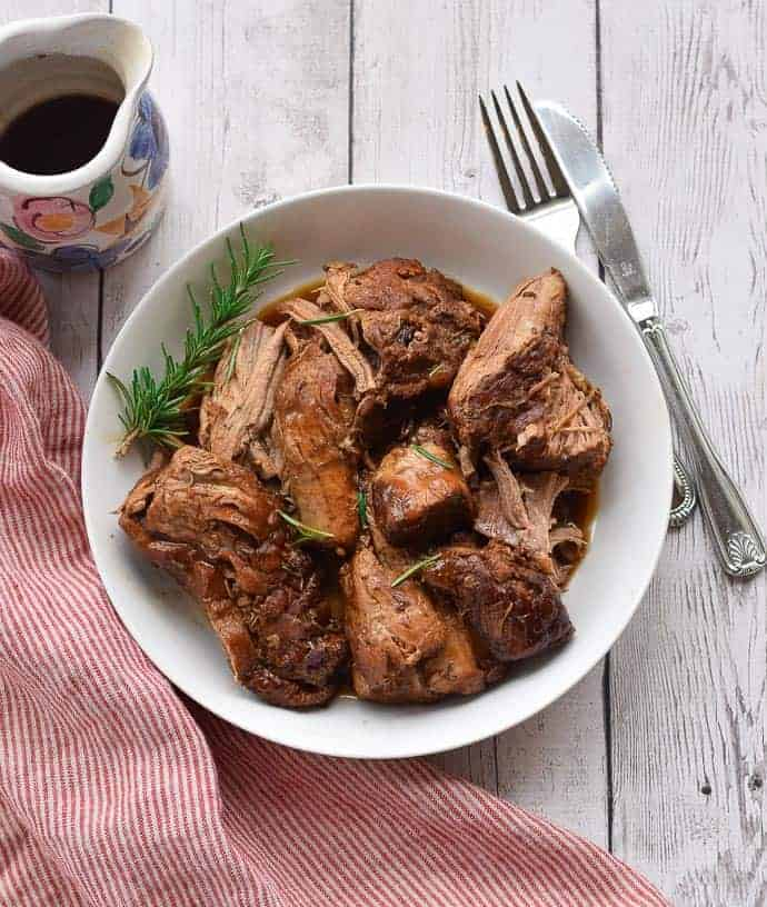Instant Pot pork tenderloin in a white bowl.
