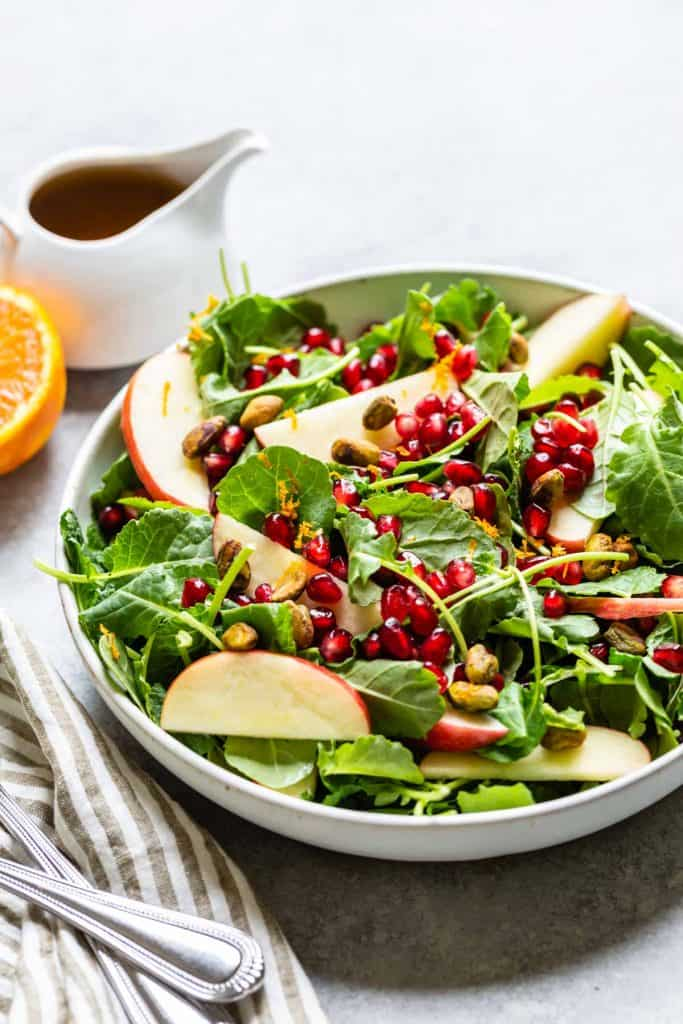 kale salad with orange and dressing on the side