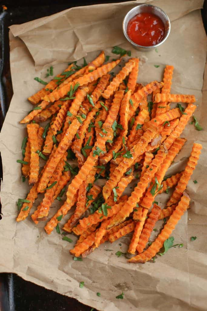 Oven Roasted Spiced Sweet Potato Fries on a sheet pan