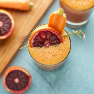 Blood Orange, Carrot and Turmeric Smoothie with carrot and blood orange garnish