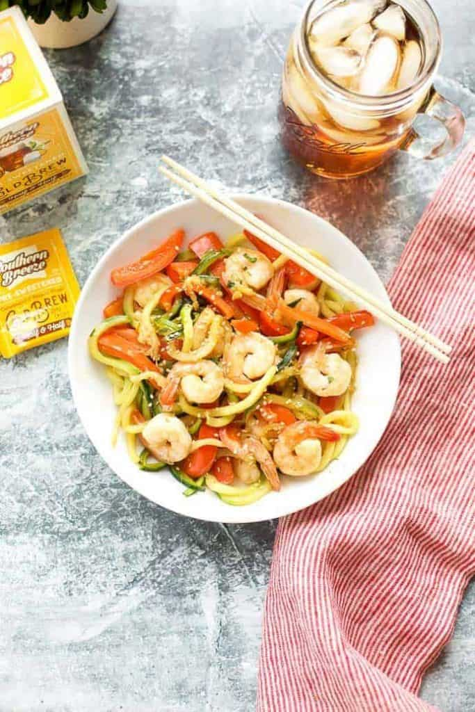 Garlic Shrimp with zucchini noodles in a white bowl with chopsticks