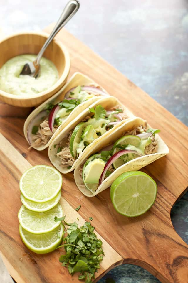 Instant Pot Pulled Pork Tacos with avocado and onion