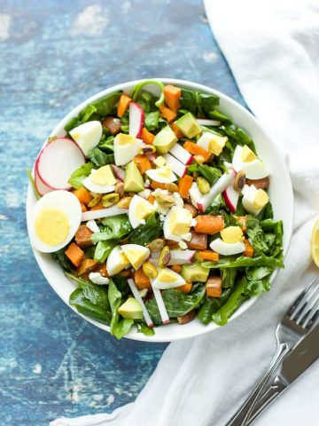 Spiced Sweet Potato and Kale Salad with pistachios, eggs and radishes. #glutenfree seasonalcravings.com