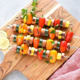 Chicken Sausage Skewers with Vegetables on skewers on a cutting board