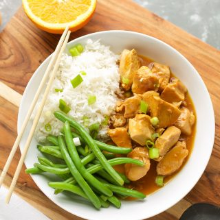 Instant Pot Orange Chicken with green beans in a white bowl