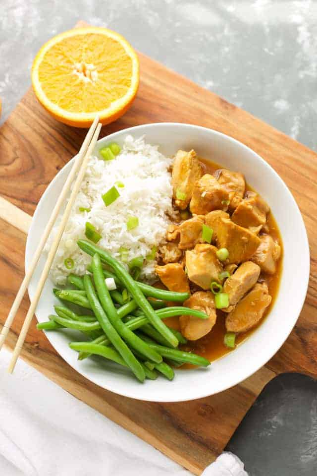 healthy Instant Pot Orange Chicken with green beans in a white bowl