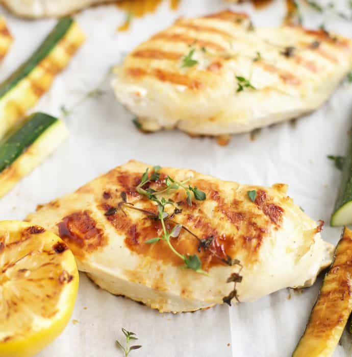 Grilled lemon thyme chicken with grilled zucchini on a sheet pan