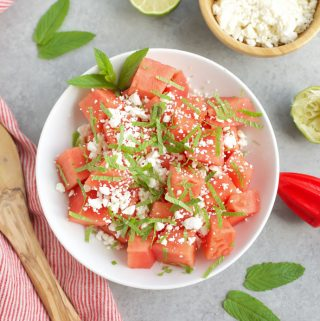 skinny watermelon feta salad in white bowl with mint