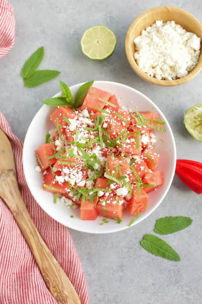 Skinny watermelon salad in a white bowl