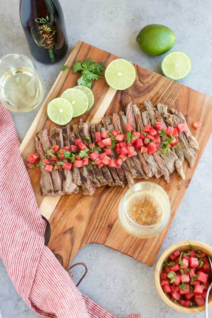 Grilled Skirt Steak with Watermelon Salsa and limes