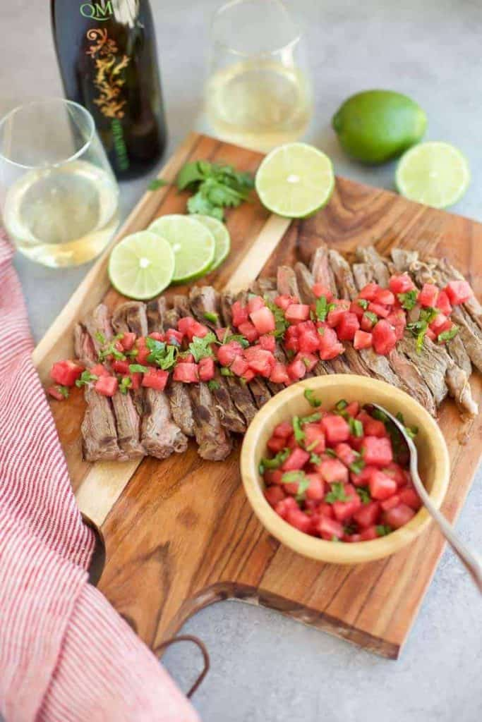 Grilled Skirt Steak with Watermelon Salsa on a cutting board