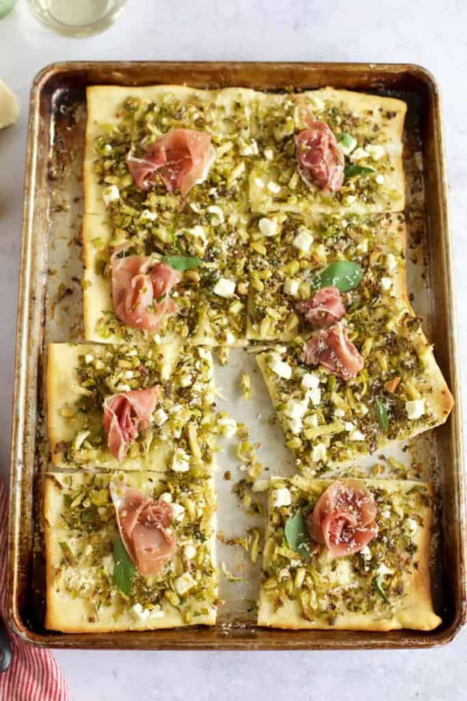 Brussel sprout and prosciutto pizza on a pizza pan