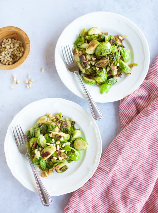 Sauteed Brussels Sprouts with Pancetta on two white plates