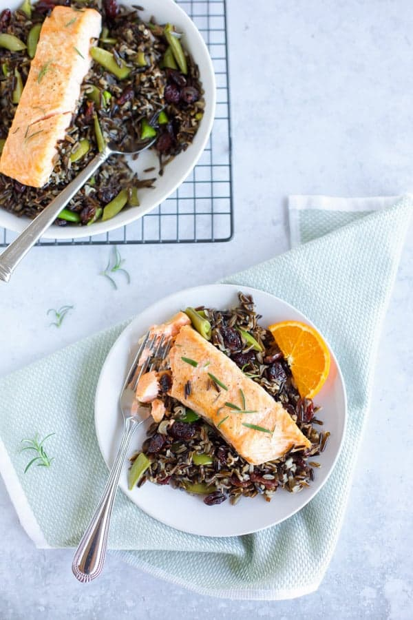 baked salmon with black rice on a white plate