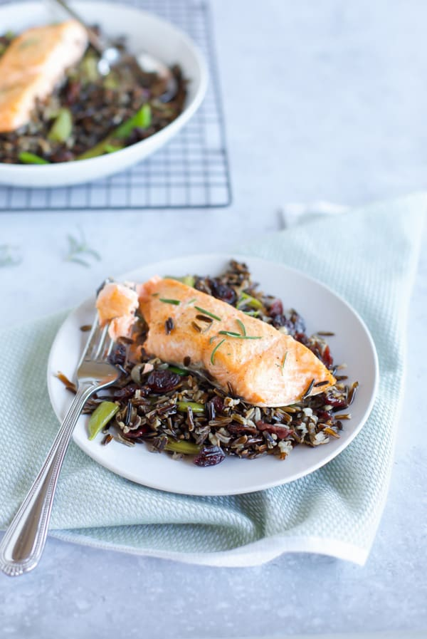 baked salmon with black rice close up with fork