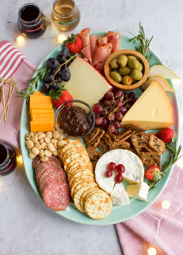 wine and cheese platter on a blue plate