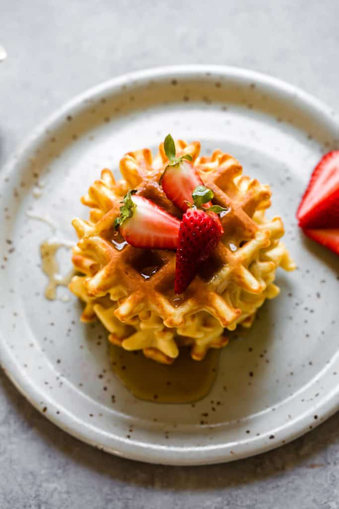 waffles with strawberries overhead shot