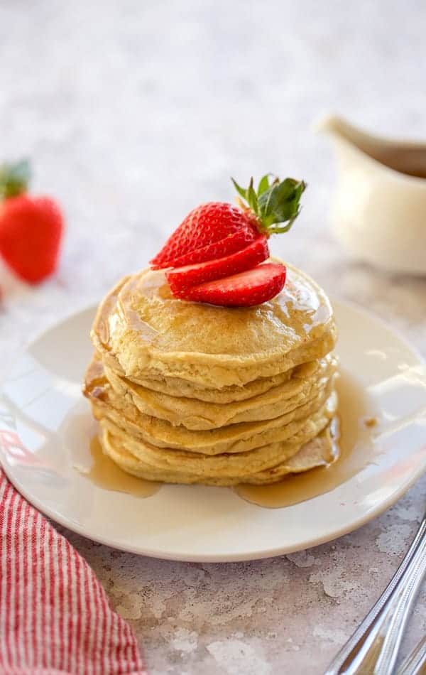 gluten free pancakes on a white plate