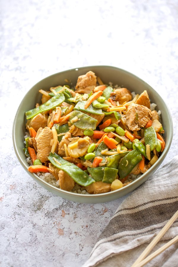 chicken stir fry with frozen vegetables in a bowl