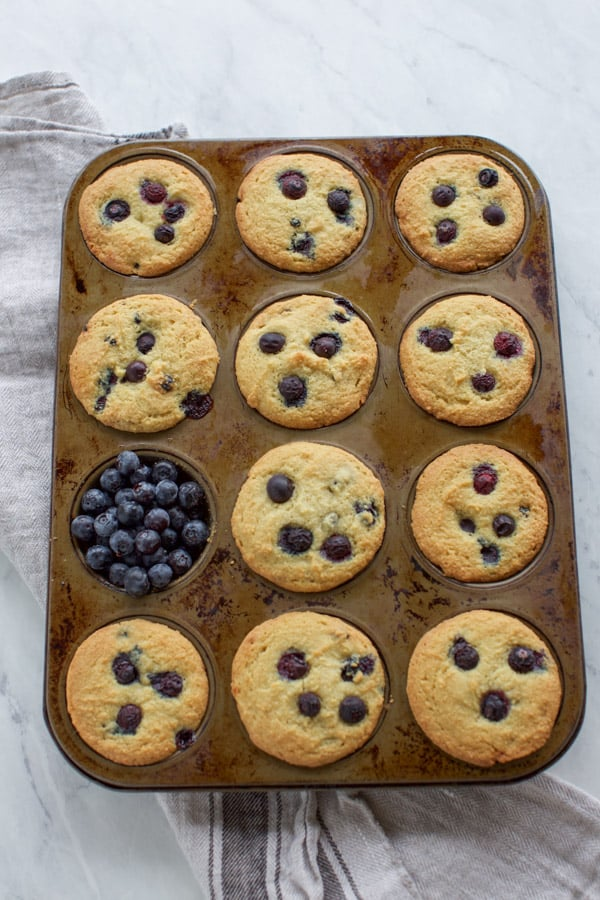 almond flour blueberry muffins cooked in a tin