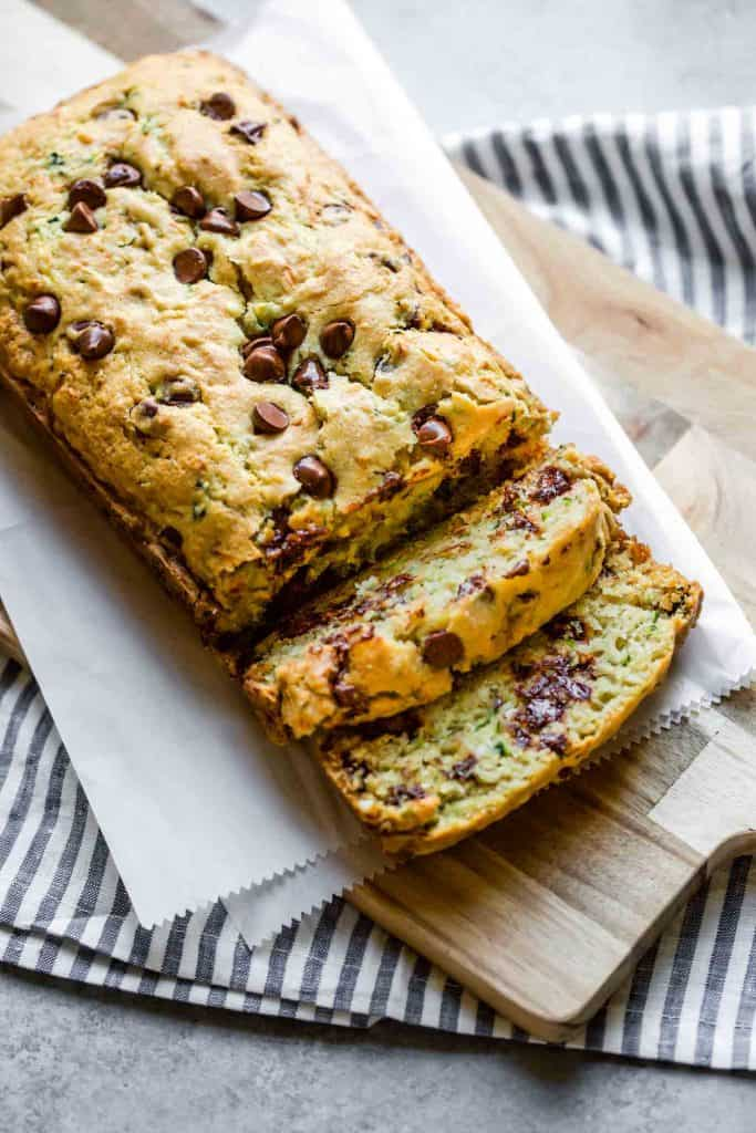 gluten free chocolate chip zucchini bread on a cutting board with slices
