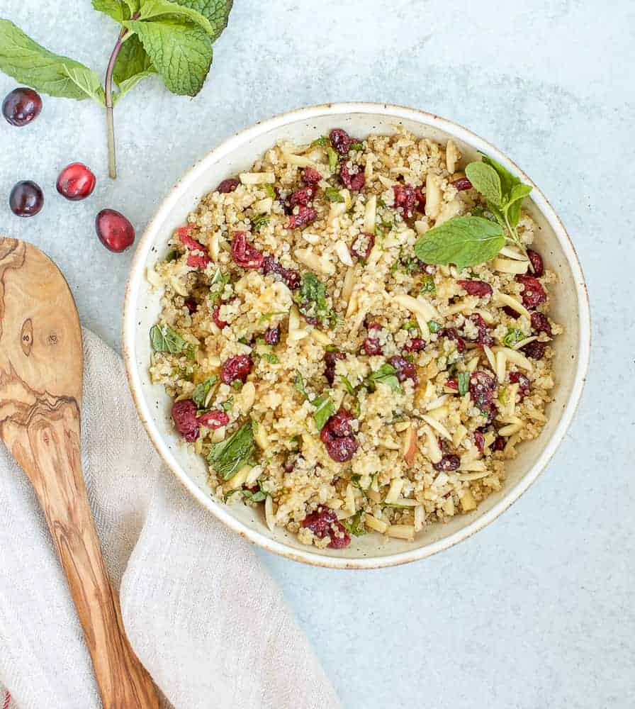 cranberry almond quinoa with a wooden spoon