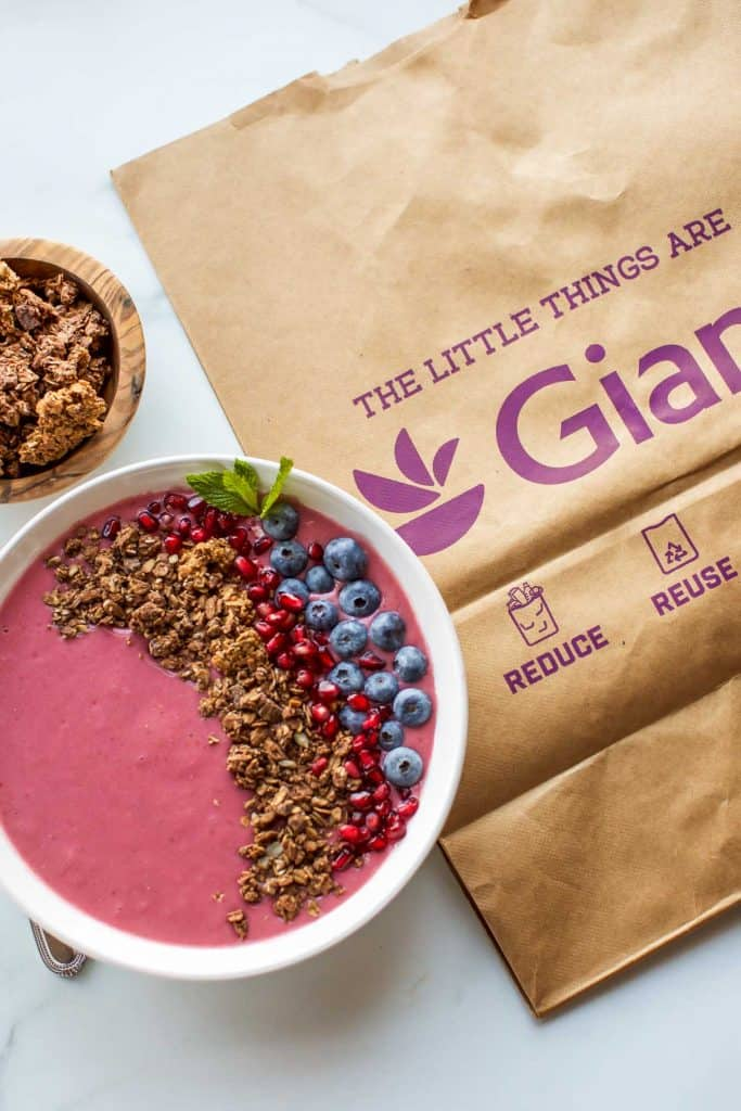 smoothie bowl with granola and a paper Giant bag