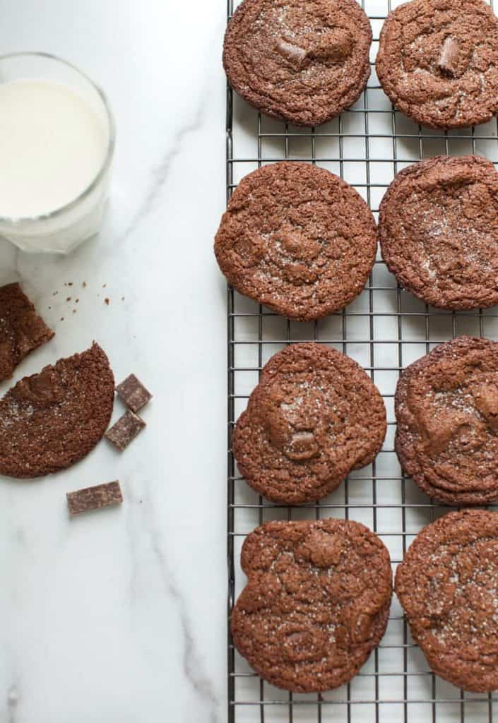gluten free chocolate cookies on a cooling rack with milk