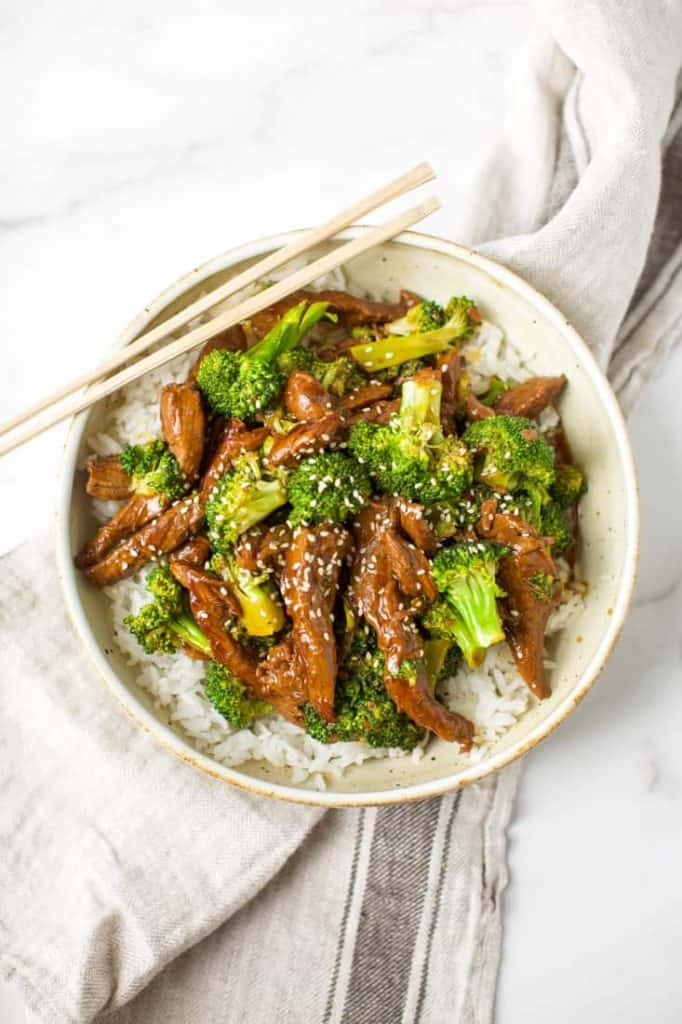 instant pot beef and broccoli with chopsticks