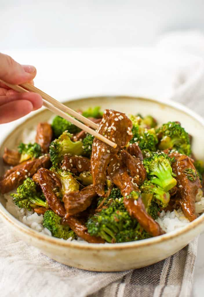 gluten free instant pot beef and broccoli with chopsticks close up