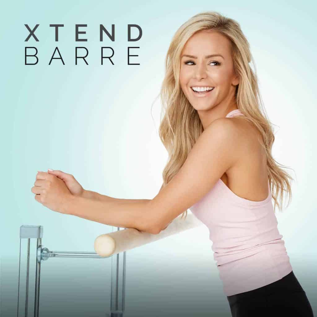 photo of woman working out on barre