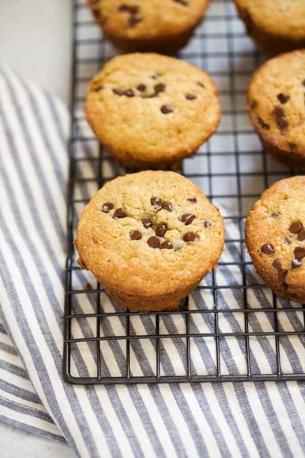 gluten free banana chocolate chip muffins on a cooling rack