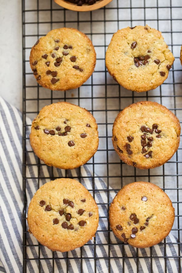gluten free muffins with chocolate chips on a cooling rack