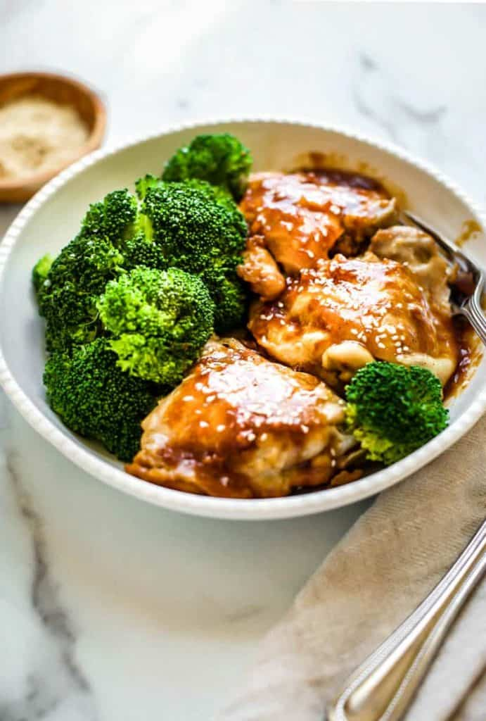 instant pot chicken teriyaki in a white bowl with broccoli