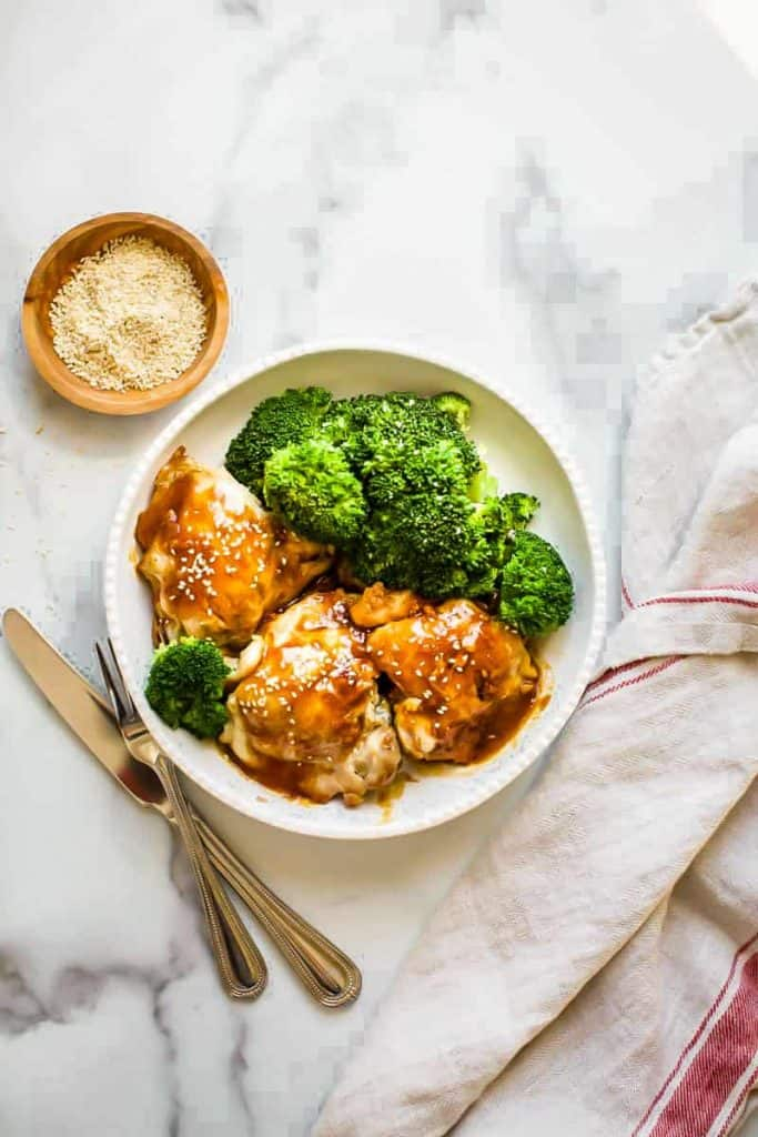 instant pot teriyaki chicken with broccoli on a white plate