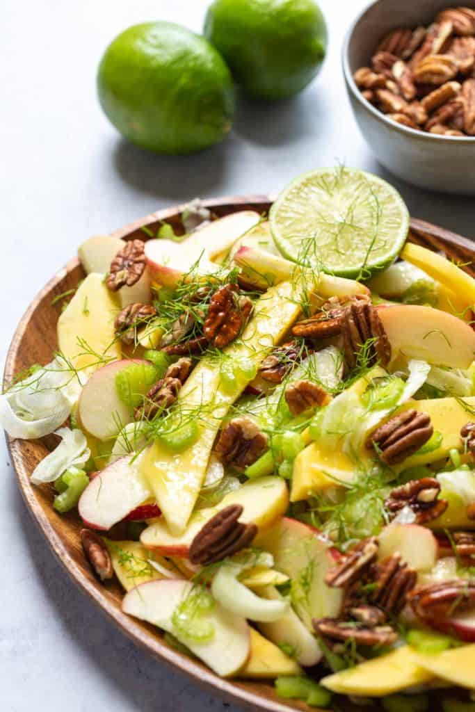 close up of fennel mango and apple salad with dressing