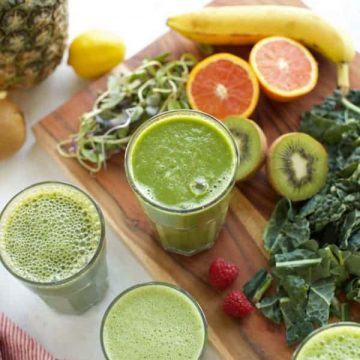 four green smoothies in glasses