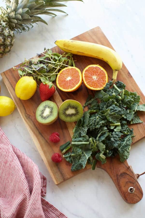 ingredients for green smoothies on a cutting board