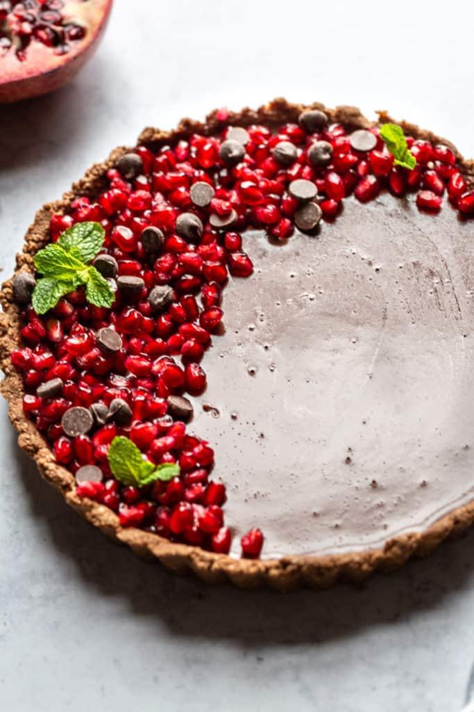 close up chocolate tart with pomegranate
