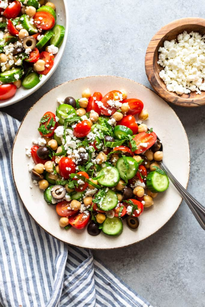 mediterranean chickpea salad on two white plates