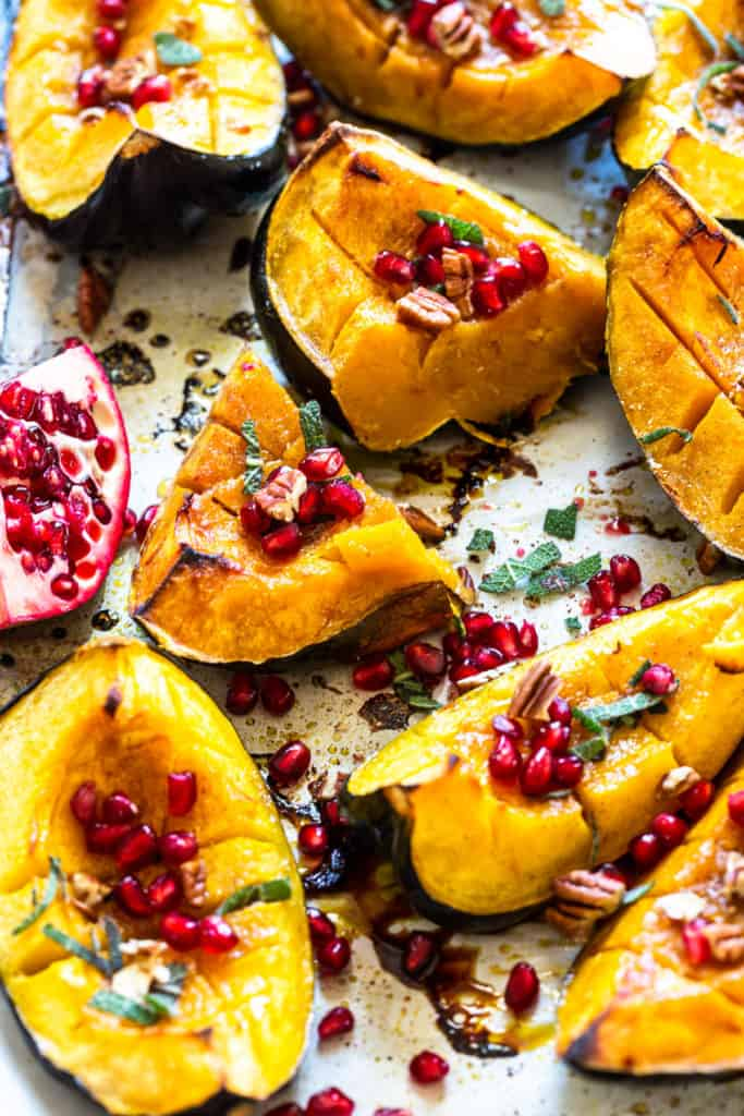 buttery roasted acorn squash on a sheet pan