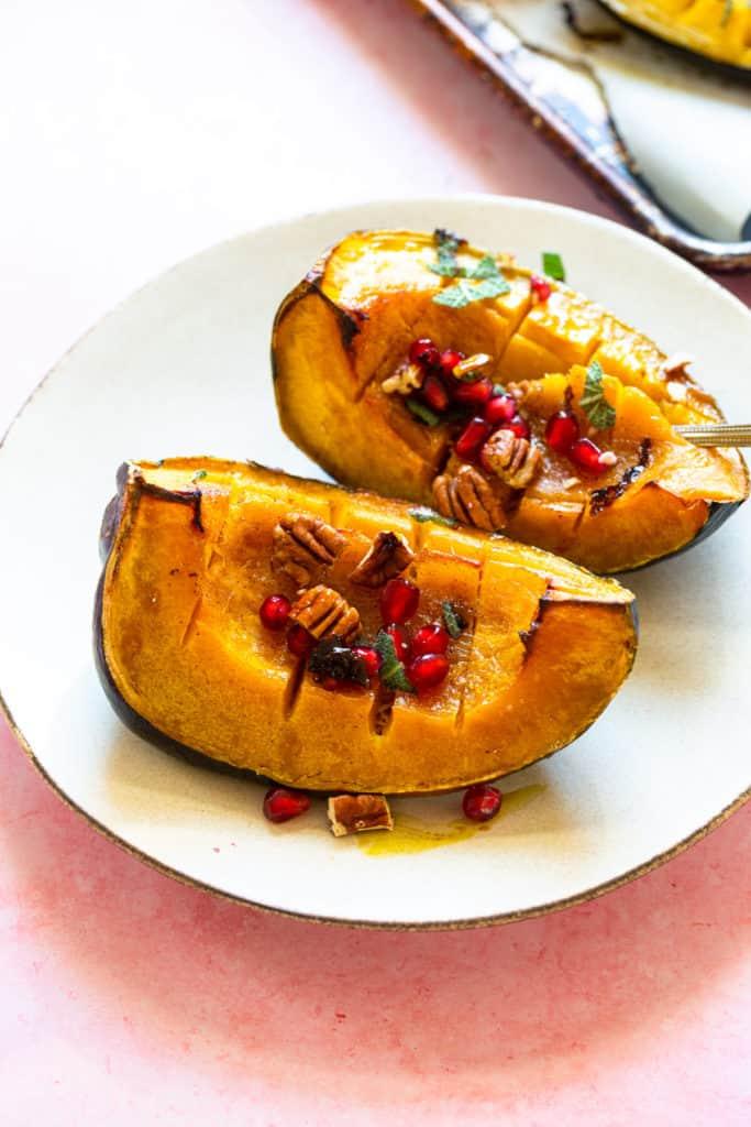 acorn squash on a white plate