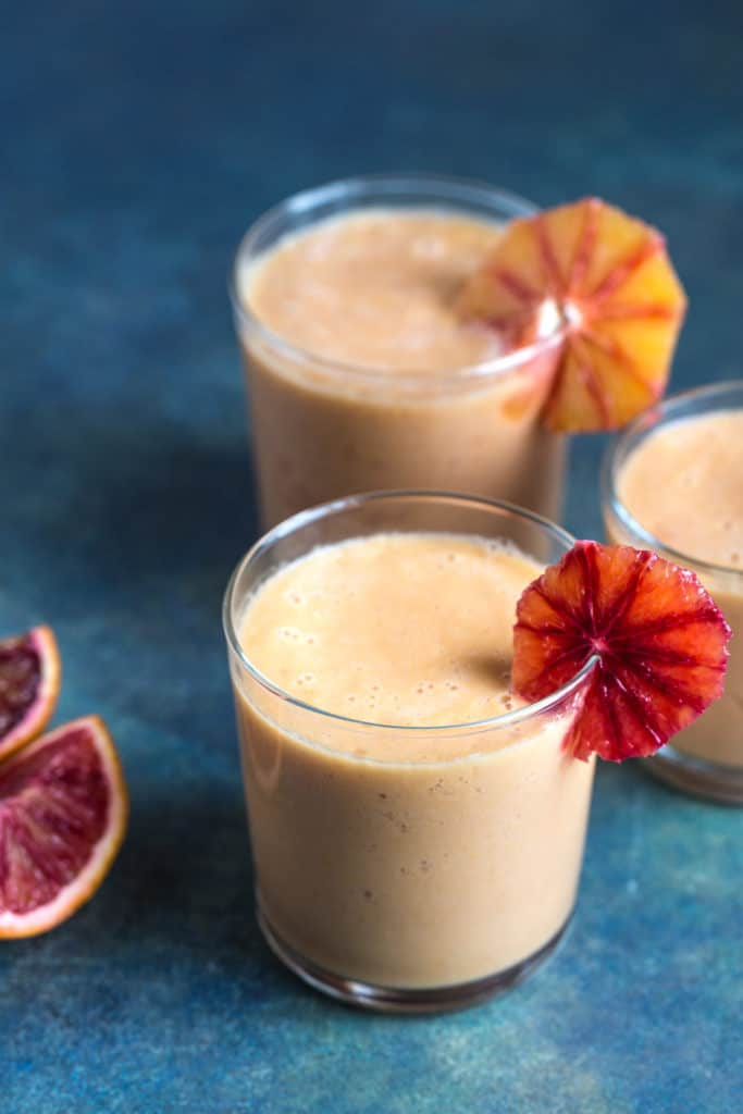 two blood orange and mango smoothies